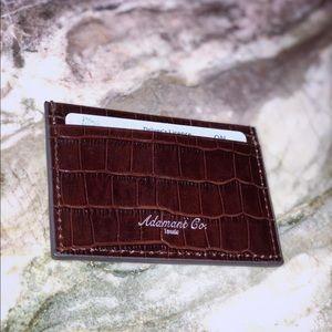 Brown genuine leather cardholder.
